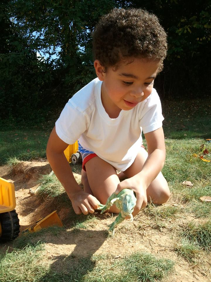 Ezra in the backyard playing