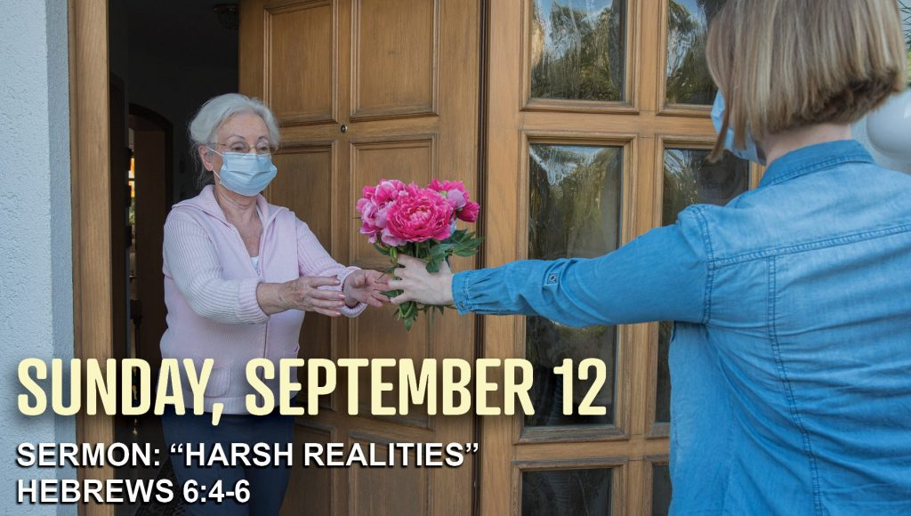 masked woman sharing flowers with masked neighbor